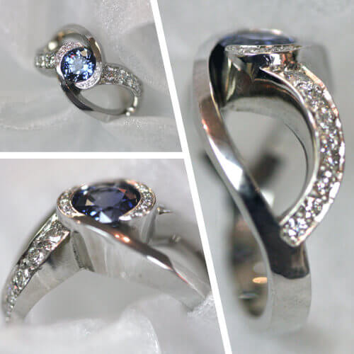 Unique infinity ring with blue center gemstone and white diamonds
