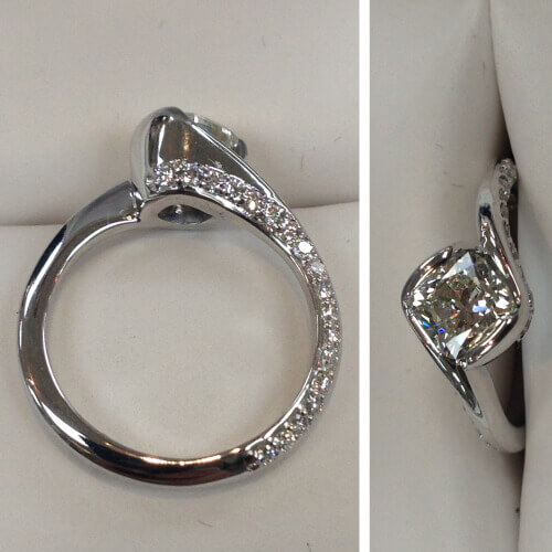 Diamond ring with diamonds alongside of band