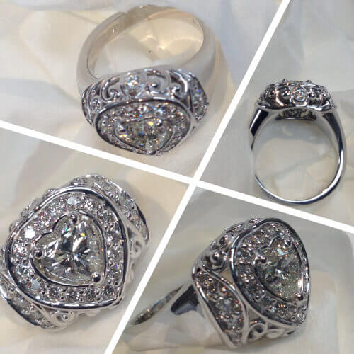 Heart shaped diamond surrounded by diamonds in a crown setting