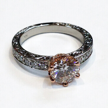 rose and white gold setting with diamond and side accents