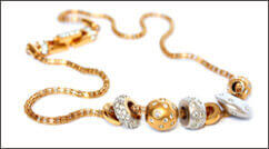 Gold necklace with diamonds on gold beads
